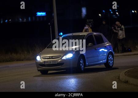 A car believed to be carrying Carme Forcadell, Speaker of the Catalonian parliament, arrives to the Alcala Meco prison after a judge ordered Forcadell free on bail but to be held in custody until she pays the 150,000-euro bail, in Alcala de Henares, outside Madrid, Spain, early November 10, 2017 REUTERS/Juan Medina - Stock Photo