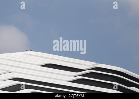 Anti-government demonstrators are seen on the roof of the Jockey Club Innovation Tower at the Polytechnic University in Hong Kong, China, November 16, 2019. REUTERS/Adnan Abidi