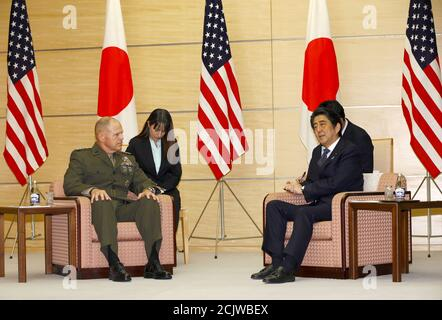 Gen. Robert B. Neller, U.S. Commandant of the Marine Corps, talks with Japanese Prime Minister Shinzo Ab at Abe's official residence in Tokyo, Wednesday, Nov. 25, 2015. REUTERS/Shizuo Kambayashi/Pool Stock Photo