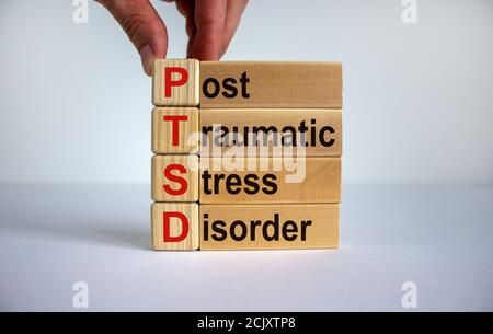 Concept words 'PTSD, post-traumatic stress disorder' on cubes and blocks on a beautiful white background. Copy space.