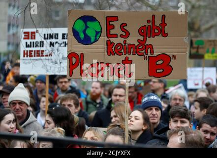 Demonstrators take part in a 'Fridays for Future' protest claiming for urgent measures to combat climate change, in Berlin, Germany, March 29, 2019. The sign reads 'There is no Planet B'. REUTERS/Fabrizio Bensch - Stock Photo