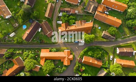 Aerial view of a small village.Top view of traditional housing estate in Czech. Looking straight down with a satellite image style.Houses from above,