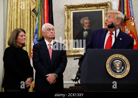 U.S. President Donald Trump presents the Presidential Medal of Freedom to Roger Penske in the Oval Office at the White House in Washington, U.S., October 24, 2019. REUTERS/Tom Brenner - Stock Photo