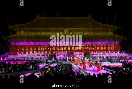 Models perform to celebrate the new year during a countdown event at Tai Miao, the imperial ancestral temple in the Forbidden City, in Beijing, China, December 31, 2015. REUTERS/Jason Lee - Stock Photo