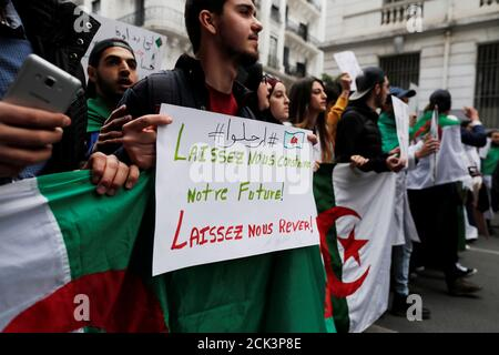 Students march during a protest calling on President Abdelaziz Bouteflika to quit, in Algiers, Algeria March 19, 2019. The sign reads: 'Get out, let us build our future, let us dream'.  REUTERS/Zohra Bensemra - Stock Photo