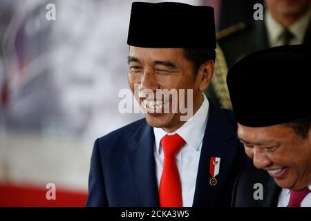 Indonesian President Joko Widodo reacts to journalists, following his inauguration and a swearing-in ceremony, at the House of Representatives building in Jakarta, Indonesia, October 20, 2019. REUTERS/Willy Kurniawan