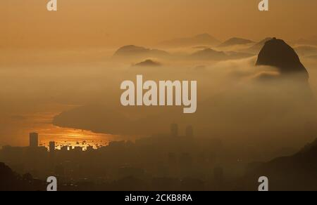 Sugarloaf Mountain is seen from the Vista Chinesa (Chinese View) during sunrise in Rio de Janeiro, Brazil, May 4, 2016. REUTERS/Ricardo Moraes SEARCH 'RIO POSTCARDS' FOR THIS STORY. SEARCH 'THE WIDER IMAGE' FOR ALL STORIES. - Stock Photo