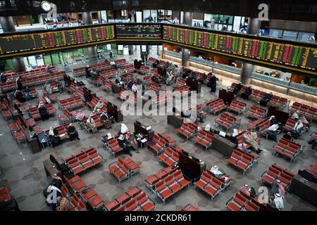 Kuwaiti investors sit in the arena of the Kuwait Bourse (Stock Exchange) floor in Kuwait City, Kuwait, January 8,2020. REUTERS/Stephanie McGehee - Stock Photo