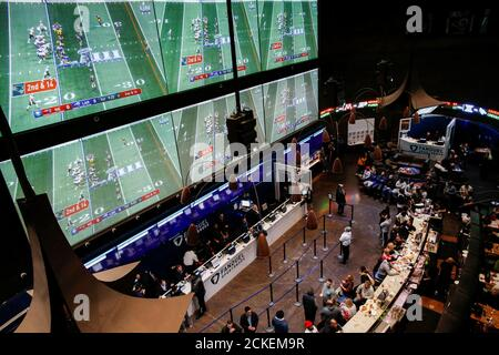 People make their bets at the FANDUEL sportsbook during the Super Bowl LIII in East Rutherford, New Jersey, U.S., February 3, 2019. REUTERS/Eduardo Munoz