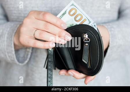 hands holding hundred dollar and wallet - Stock Photo