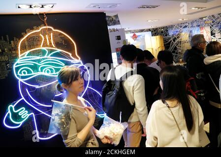 A light fixture of 'Pepe the Frog', a widely used pro-democracy protest mascot in Hong Kong, is seen at a booth of independent fairs, selling protest-themed artwork, toys and accessories, ahead of Lunar New Year in Hong Kong, China January 20, 2020. REUTERS/Tyrone Siu - Stock Photo