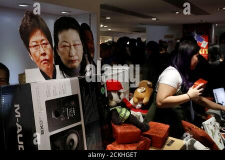 Images of Hong Kong's Ehief Executive Carrie Lam and Justice Secretary Teresa Cheng Yuet-wah are seen at a booth of independent fairs, selling protest-themed artwork, toys and accessories, ahead of Lunar New Year in Hong Kong, China January 20, 2020. REUTERS/Tyrone Siu - Stock Photo