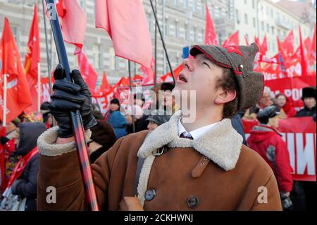Activists and supporters of the Russian Communist Party gather before a march to celebrate the Defender of the Fatherland Day, which was before known as Soviet Army and Navy Day, in Moscow, Russia February 23, 2019. REUTERS/Maxim Shemetov Stock Photo