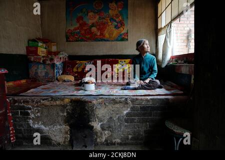 Chinese former 'comfort woman' Zhang Xiantu rests on a traditional brick bed in her house in Xiyan Town, Shanxi Province, China, July 18, 2015. 'Comfort women' is the Japanese euphemism for women who were forced into prostitution and sexually abused at Japanese military brothels before and during World War Two. Xiantu is the only surviving 'comfort woman' of the 16 plaintiffs in Shanxi who sued the Japanese government in 1995 for abducting girls and using them as 'comfort women' during World War Two. According to information from China's Commission of Inquiry into the Facts of Comfort Women be