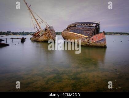 Boat graveyard at Pin Mill on the river Orwell, Shotley Peninsula, near Ipswich, Suffolk, UK - Stock Photo