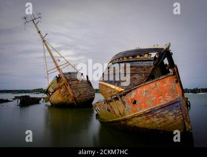 Boat graveyard at Pin Mill on the river Orwell, Shotley Peninsula, near Ipswich, Suffolk, UK - Stock Photo