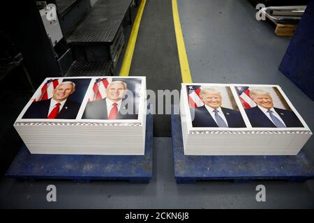 Official portraits of President Donald Trump and Vice President Mike Pence are seen at the Government Publishing Office in Washington, U.S., November 29, 2017. REUTERS/Aaron P. Bernstein