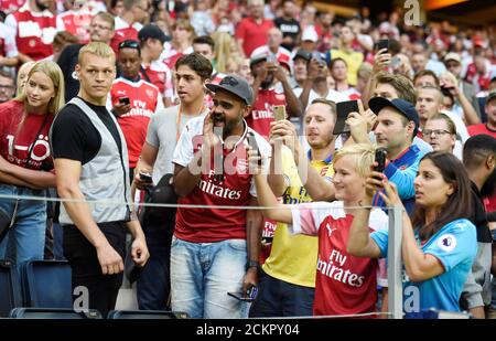 Soccer Football - Pre Season Friendly - Lazio v Arsenal - Friends Arena, Stockholm, Sweden - August 4, 2018   Arsenal fans take photos during the match   REUTERS/Fabian Bimmer - Stock Photo