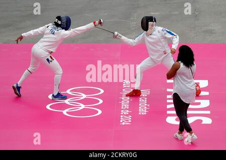 Athletes fence during a sport's demonstrations inside the Grand Palais as the French capital bids to host the 2024 Olympic and Paralympic Games, in Paris, France, July 23, 2017. Picture taken July 23, 2017. REUTERS/Charles Platiau