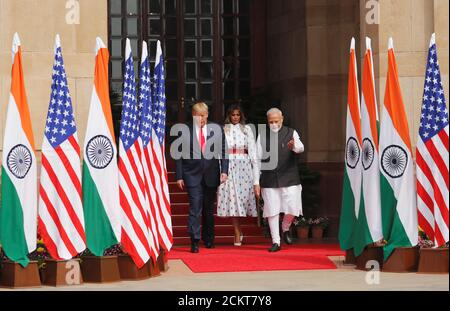 U.S. President Donald Trump and first lady Melania Trump are shown the way by Indian Prime Minister Narendra Modi, at Hyderabad House in New Delhi, India, February 25, 2020. REUTERS/Al Drago - Stock Photo