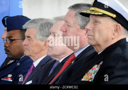 U.S. Secretary of the Army John McHugh (from 2nd L-R), Secretary of the Navy Ray Mabus, Secretary of the Air Force Michael Donley and Commander of the National Capital Medicine Joint Task Force U.S. Navy Vice Admiral John Mateczun participate in the dedication ceremony at the Walter Reed National Military Medical Center in Bethesda, Maryland, November 10, 2011.  Washington's storied 102-year-old Walter Reed Army Medical Center, which treated some 18,000 troops that fought in Iraq and Afghanistan as well as U.S. President Dwight Eisenhower, who died there, and Generals John J. Pershing and Doug - Stock Photo