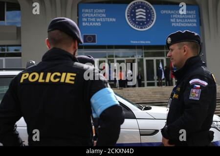 Members of the European Border and Coast Guard Agency known as FRONTEX stand in front of their vehicles before starting a mission on Albania-Greece border, in Tirana, Albania May 21, 2019. REUTERS/Florion Goga - Stock Photo