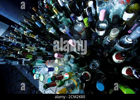 Empty glass bottles are seen beside glass recycling bins in Frankfurt, Germany, May 16, 2018. Picture taken on May 16, 2018.   REUTERS/Ralph Orlowski - Stock Photo