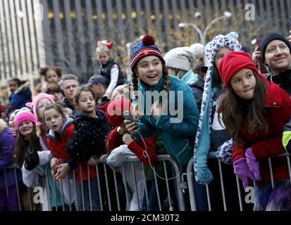 People watch floats make their way down 6th avenue during the 89th Macy's Thanksgiving Day Parade in the Manhattan borough of New York, November 26, 2015. REUTERS/Shannon Stapleton - Stock Photo