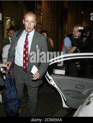 England Rugby World Cup team's coach Clive Woodward leaves a hearing in Sydney on October 30, 2003 after discussing the consequences for having 16 men on the field in their Rugby World Cup game against Samoa on October 26. REUTERS/Adrees Latif  AL/CP - Stock Photo