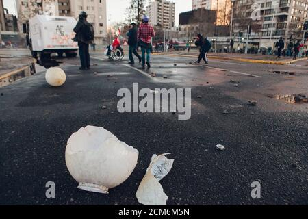 SANTIAGO, CHILE - SEPTEMBER 11, 2020 - Remains of a street light destroyed by protesters. Hundreds of people came to the Plaza Baquedano to commemorat - Stock Photo