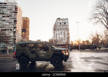 SANTIAGO, CHILE - SEPTEMBER 11, 2020 - Armored police vehicle warning protesters about dissuasive means that will be used to hold the protest. Hundred - Stock Photo