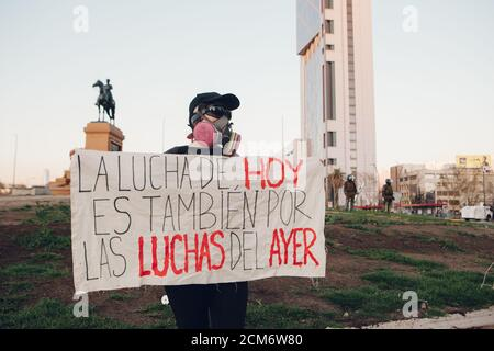 SANTIAGO, CHILE - SEPTEMBER 11, 2020 - A young woman protests with a sign that says 'Today's struggle is also for yesterday's struggles'. Hundreds of - Stock Photo