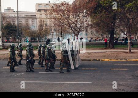 SANTIAGO, CHILE - SEPTEMBER 11, 2020 - Riot police repress protesters. Hundreds of people came to the Plaza Baquedano to commemorate the 47th annivers - Stock Photo