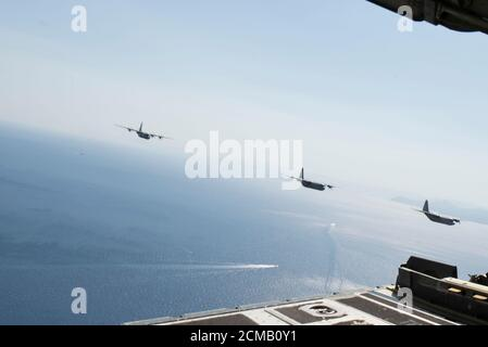 C-130J Super Hercules aircraft, one from the Hellenic armed forces and two assigned to the 86th Airlift Wing, fly over Megara Bay, Greece, during Operation Stolen Cerberus VII, Sept. 11, 2020. The exercise is designed to enhance readiness and demonstrate a shared commitment to a peaceful, stable and secure Europe. (U.S. Air Force photo by Airman 1st Class Taylor D. Slater)