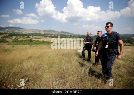 Members of the European Border and Coast Guard Agency (FRONTEX) patrol near Albania-Greece border, in Kapshtica near Korce, Albania, July 23, 2019. Picture taken July 23, 2019. REUTERS/Florion Goga - Stock Photo