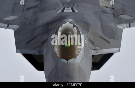 A pilot looks up from a U.S. F-22 Raptor fighter as it prepares to refuel mid-air with a KC-135 refuelling plane during a flight to Britain from Mihail Kogalniceanu air base in Romania, April 25, 2016. Toby Melville: 'I hate flying, so when I was asked if I fancied a day trip from a US air force base in Britain to near the border with Crimea, to photograph a mid-air refuel of US fighter bomber planes, I did initially hesitate. I have been sick many a time on previous assignments; flying in military helicopters over Baghdad, in planes hugging mountains in Kosovo and on six-seater propeller plan - Stock Photo