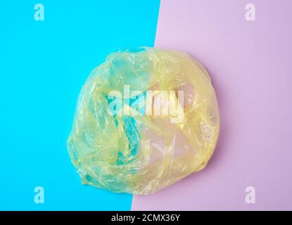 open empty plastic bag for products on a colored background