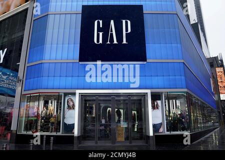 A closed Gap store is pictured in Times Square following the outbreak of Coronavirus disease (COVID-19), in the Manhattan borough of New York City, New York, U.S., March 23, 2020. REUTERS/Carlo Allegri - Stock Photo