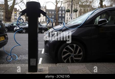 Electric cars are plugged into a charging point in London, Britain, April 7, 2016. To match Insight ELECTRIC-CAR/COMMODITIES   REUTERS/Neil Hall/File Photo - Stock Photo