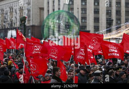 Activists and supporters of the Russian Communist Party gather before a flower-laying ceremony to mark the anniversary of Soviet leader Josef Stalin's birthday at his grave by the Kremlin wall in central Moscow, Russia, December 21, 2015. REUTERS/Maxim Shemetov Stock Photo