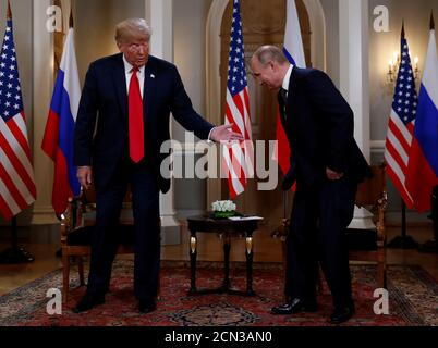 U.S. President Donald Trump meets with Russia's President Vladimir Putin in Helsinki, Finland, July 16, 2018. REUTERS/Kevin Lamarque - Stock Photo