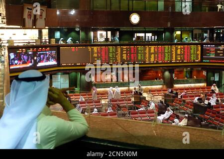 Screens showing U.S. President-elect Donald Trump are seen as traders monitor stock information at the Borsa Kuwait Stock Exchange, in Kuwait City, Kuwait November 9, 2016. REUTERS/Stephanie McGehee - Stock Photo