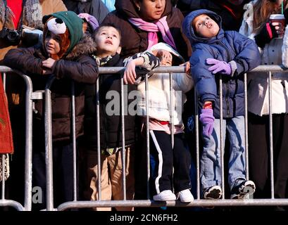 People watch as floats make their way through Times Square during the 85th annual Macy's Thanksgiving day parade in New York November 24, 2011. REUTERS/Shannon Stapleton (UNITED STATES - Tags: ENTERTAINMENT SOCIETY) - Stock Photo
