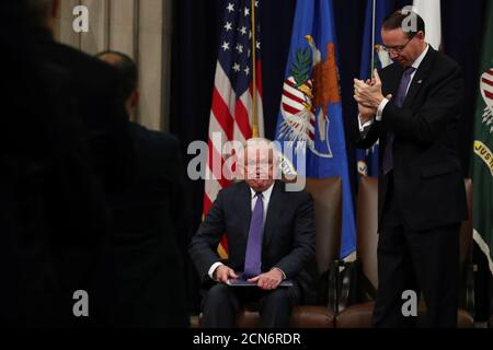 Deputy U.S. Attorney General Rod Rosenstein applauds Attorney General Jeff Sessions after his remarks at a National Opioid Summit at the Justice Department in Washington, U.S. October 25, 2018. REUTERS/Jonathan Ernst - Stock Photo