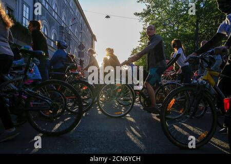 Protesters ride bicycles during an anti-government protest, in Ljubljana, Slovenia May 8, 2020. REUTERS/Borut Zivulovic - Stock Photo