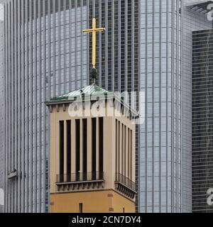 Old bell tower of the Matthaeus church in front of the modern Pollux office, Frankfurt, Germany