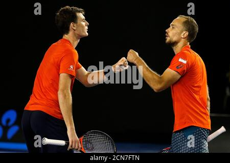 Britain's Jamie Murray (L) and Brazil's Bruno Soares react during their doubles final match at the Australian Open tennis tournament at Melbourne Park, Australia, January 31, 2016. REUTERS/Issei Kato - Stock Photo