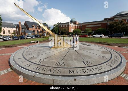 Students walk over the giant sundial in front of Morehead Planetarium on the campus of the University of North Carolina at Chapel Hill, North Carolina, U.S., September 20, 2018. Picture taken on September 20, 2018.  REUTERS/Jonathan Drake Stock Photo