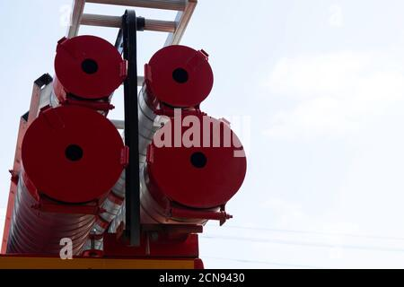 a fire truck, rear view of canisters for transporting suction hoses with fire escapes attached to them, copy space