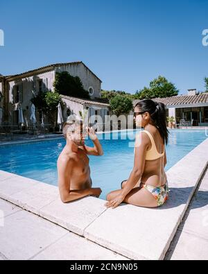 couple relaxing by the pool in the Provence France, men and woman relaxing by pool at luxury resort